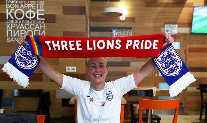 England football fan and LGBT rights campaigner Di Cunningham displays a scarf during an interview with Reuters in Volgograd, Russia, on Monday