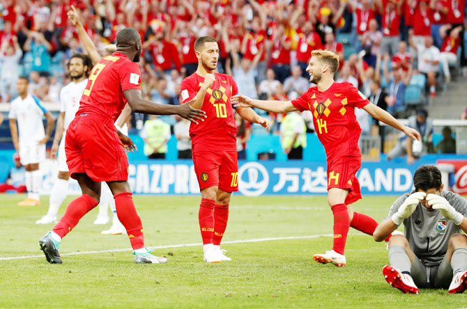 Belgium's Romelu Lukaku celebrates scoring their second goal with Eden Hazard and Dries Mertens