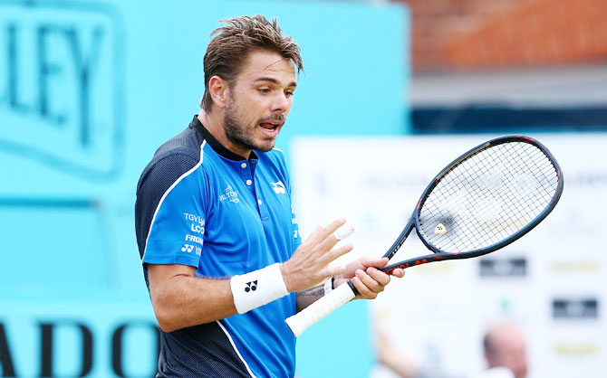 Switzerland's Stan Wawrinka reacts during his match against USA's Sam Querrey on day 3 of the Fever-Tree Championships at Queens Club in London on Wednesday