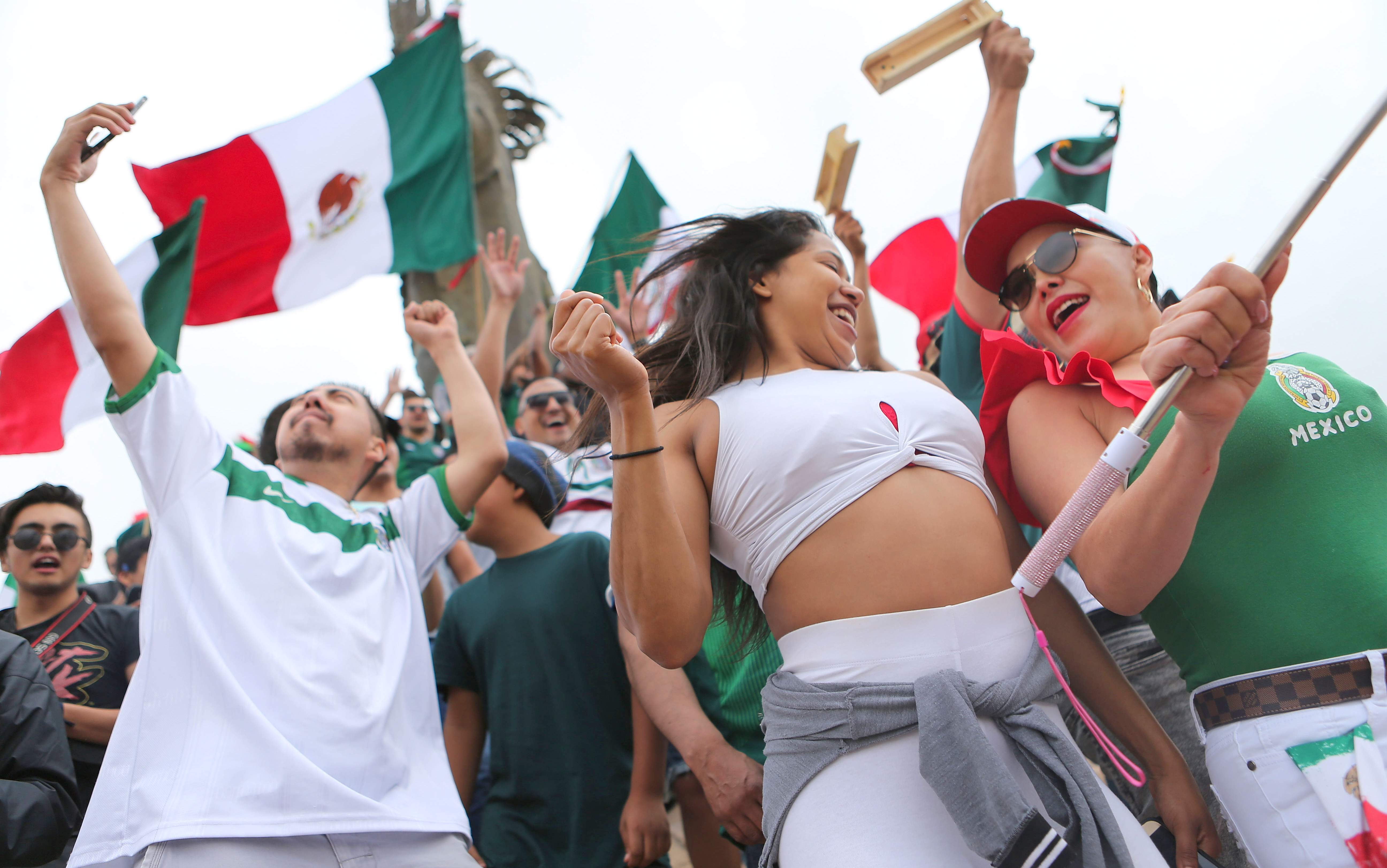 Mexico fans celebrate after their 2-1 victory over South Korea during the World Cup in Tijuana, Mexico, on Saturday