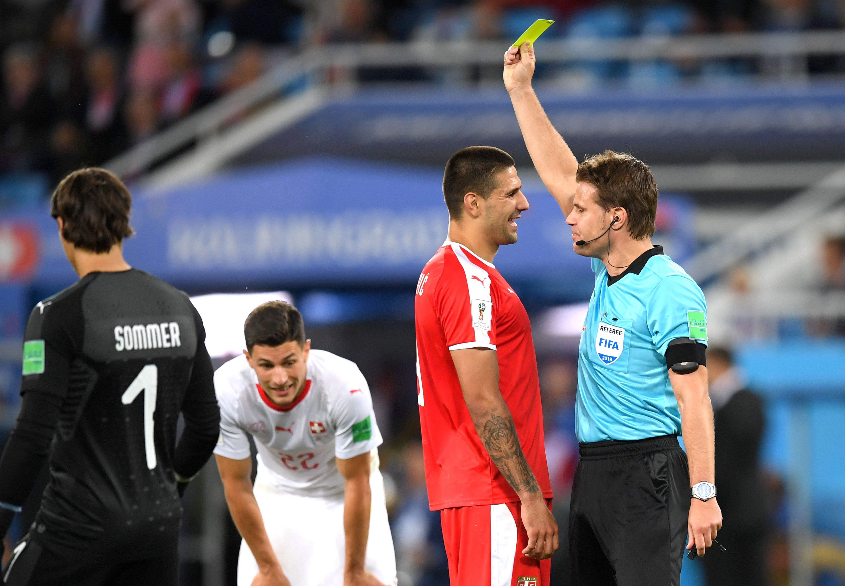Serbia's Aleksandar Mitrovic is shown a yellow card by referee Felix Brych during the 2018 FIFA World Cup Group E match against Switzerland at Kaliningrad Stadium on Friday