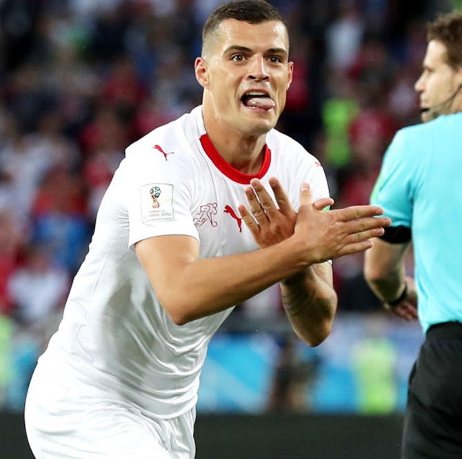 Granit Xhaka of Switzerland celebrates after scoring against Serbia