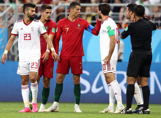 Cristiano Ronaldo argues with referee Enrique Caceres. Photograph: Jan Kruger/Getty Images