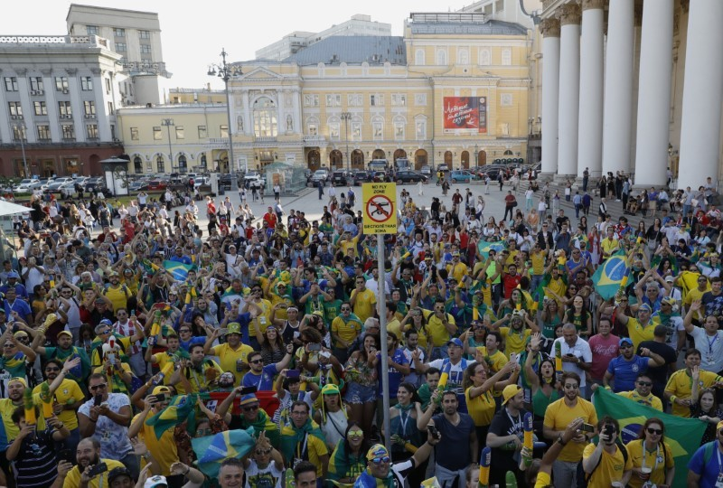 Brazil soccer team fans sing and dance near the Bolshoi Theatre in central Moscow on Tuesday