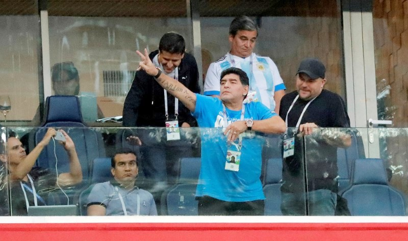 Diego Maradona watches the match between Argentina and Nigeria on Tuesday