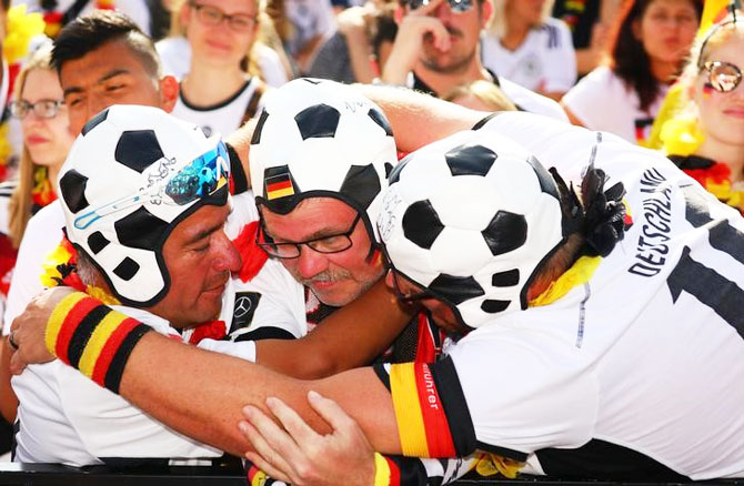 Germany fans react after the match at a public viewing area at Brandenburg Gate in Berlin on Wednesday