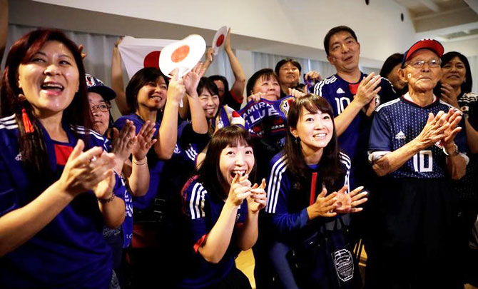 Fans react after the match at Japan House in Sao Paulo on Thursday