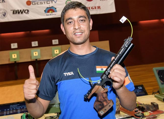 Shahzar Rizvi celebrates after winning the gold medal in the 10m air pistol event