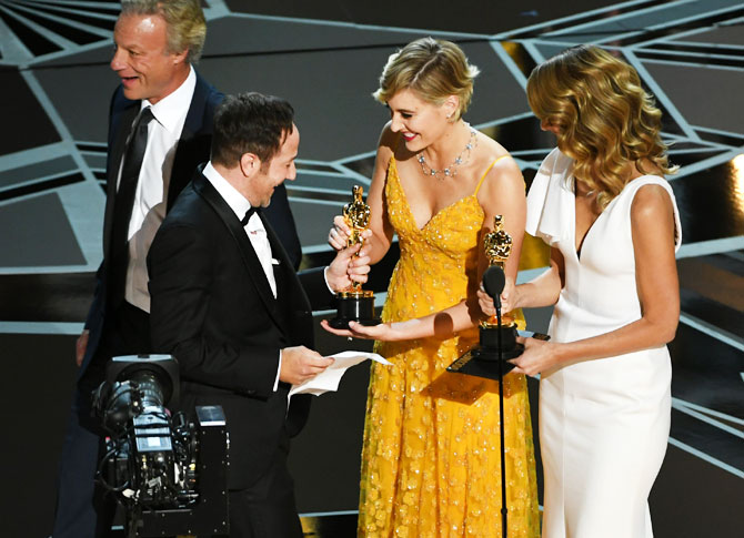 (Left to Right): Producer David Fialkow and director Bryan Fogel accept Best Documentary Feature for 'Icarus' from actor/director Greta Gerwig and actor Laura Dern onstage during the 90th Annual Academy Awards at the Dolby Theatre at Hollywood & Highland Center in Hollywood, California, on Sunday