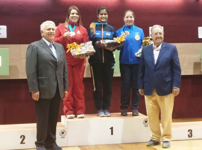 India's Manu Bhaker (centre) on the podium after winning a gold medal at ISSF World Cup in Guadalajara, Mexico on Sunday