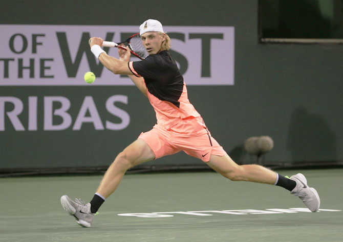 Canada's Denis Shapovalov lunges to play a backhand return to Lithuania's Ricardas Berankis