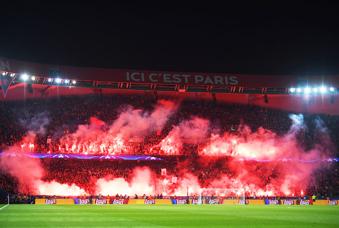 PSG fans light flares during the UEFA Champions League Round of 16 Second Leg match between Paris Saint-Germain and Real Madrid at Parc des Princes in Paris on Tuesday