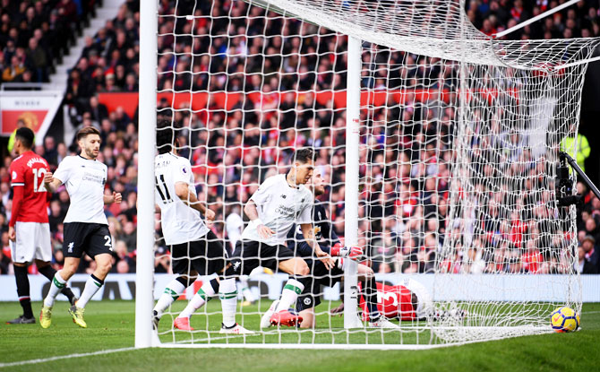 Manchester United's Eric Bailly scores an own goal