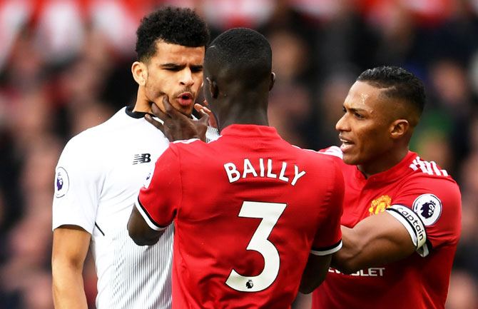 Manchester United's Eric Bailly clahses with Liverpool's Dominic Solanke