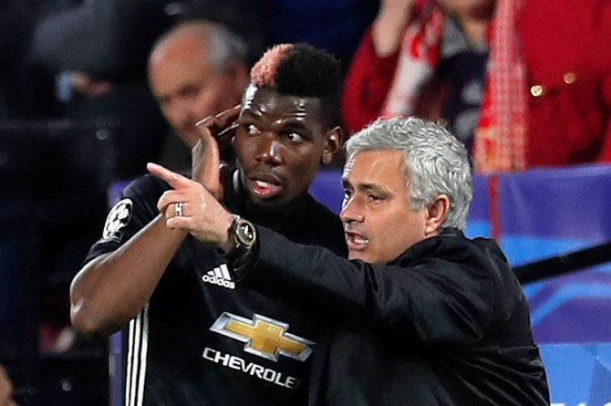 Manchester United manager Jose Mourinho speaks with Paul Pogba