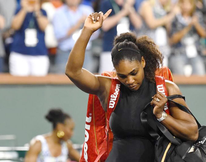 Serena Williams leaves the court after her defeat to sister Venus Williams in the third round match