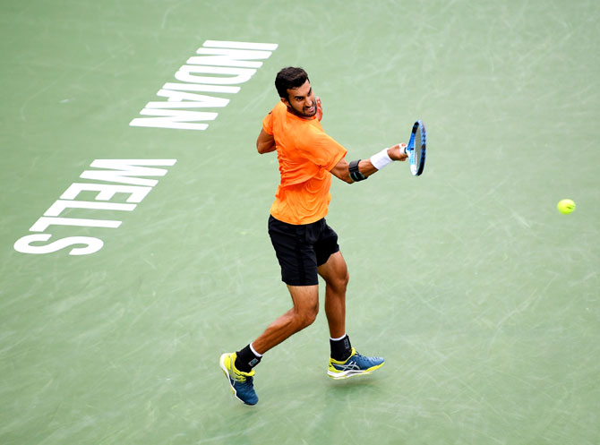 India's Yuki Bhambri plays a forehand match against USA's Sam Querrey
