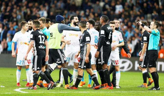 Marseille's Adil Rami and players clash after their match