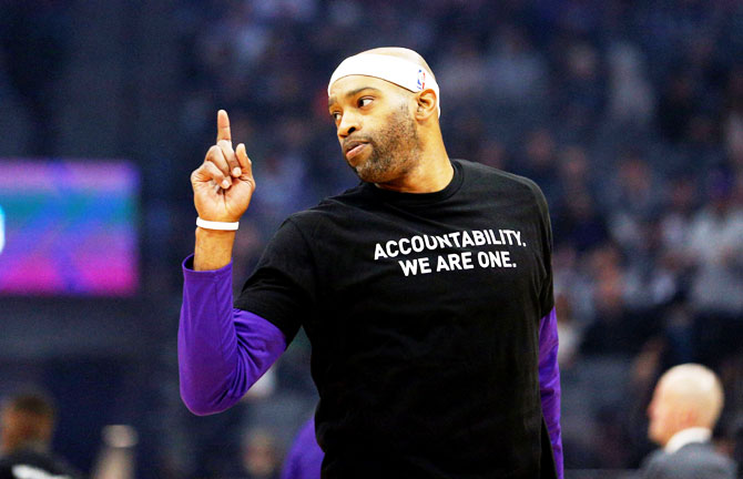 Sacramento Kings' forward Vince Carter (15) stands on the court before the start of the game against the Boston Celtics at Golden 1 Center. Players from both teams wore t-shirts during warmups in honor of Stephon Clark, a Sacramento native who was recently shot and killed by Sacramento police