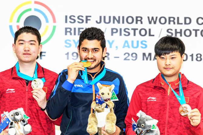 India's Anish Bhanwala on the podium with his gold medal at the ISSF Junior Shooting championships in Sydney on Monday