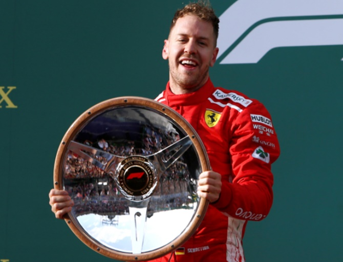 Rediff Sports - Cricket, Indian hockey, Tennis, Football, Chess, Golf - Australian GP: Opportunistic Vettel steals victory from Hamilton