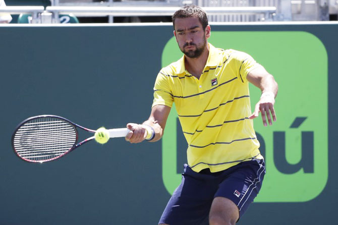 Croatia's Marin Cilic hits a forehand against Canada's Vasek Pospisil (not pictured) on day six of the Miami Open at Tennis Center at Crandon Park on Sunday