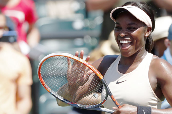 USA's Sloane Stephens smiles at her player's box after defeating Spain's Garbine Muguruza