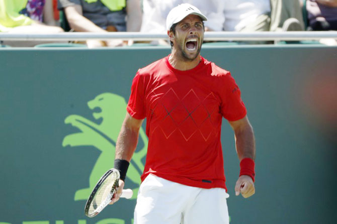 Spain's Fernando Verdasco reacts after winning a point against Australia's Thanasi Kokkinakis