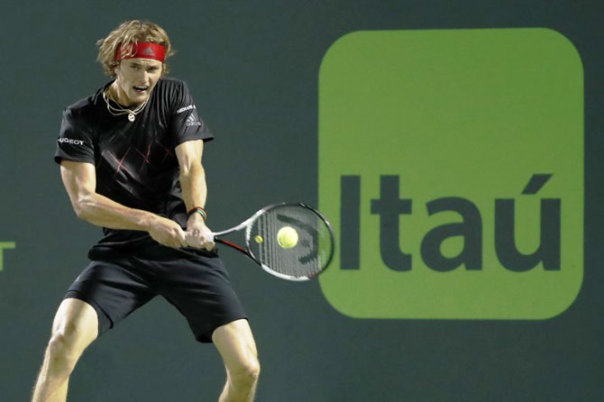 Germany's Alexander Zverev hits a backhand against Spain's David Ferrer on day seven of the Miami Open at Tennis Center at Crandon Park