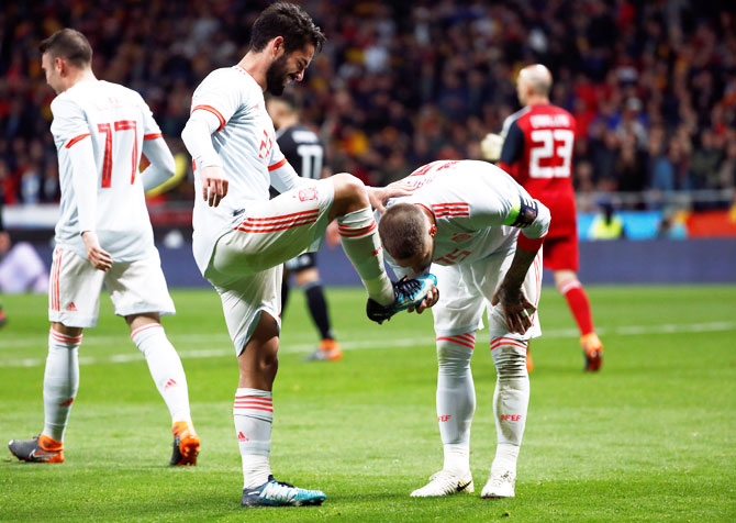 Spain's Isco celebrates with Sergio Ramos after scoring their third goal against Argentina at Wanda Metropolitano, Madrid, during their international friendly on Wednesday