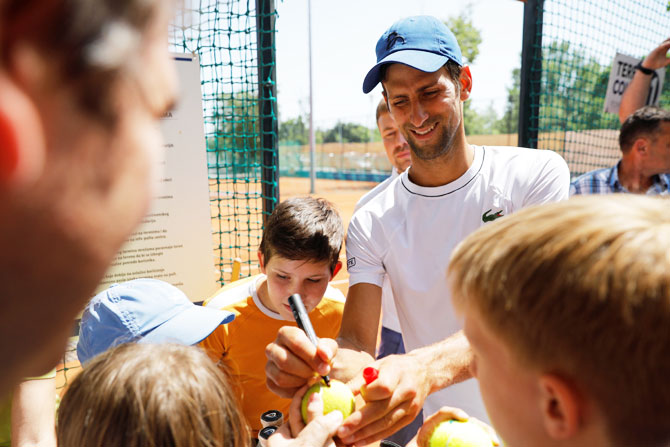 Novak Djokovic of Serbia signs autographs after a training session in Belgrade, Serbia, on Wednesday