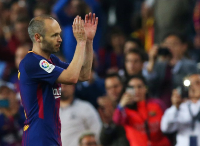 Rediff Sports - Cricket, Indian hockey, Tennis, Football, Chess, Golf - Football Briefs: Iniesta begins new chapter at J.League's Kobe