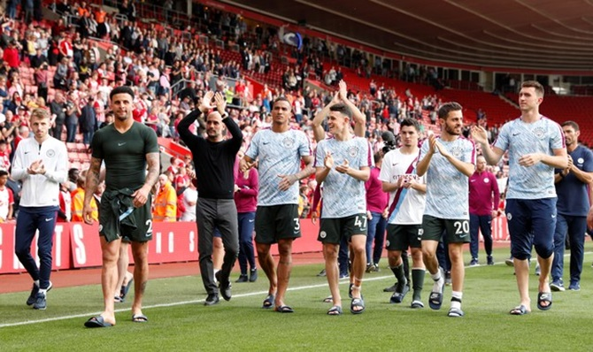 Manchester City manager Pep Guardiola and his players applaud fans after the match against Southampton on Sunday