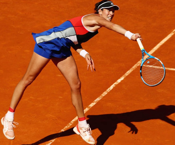 Rediff Sports - Cricket, Indian hockey, Tennis, Football, Chess, Golf - From red carpet to red dirt, Muguruza the warrior