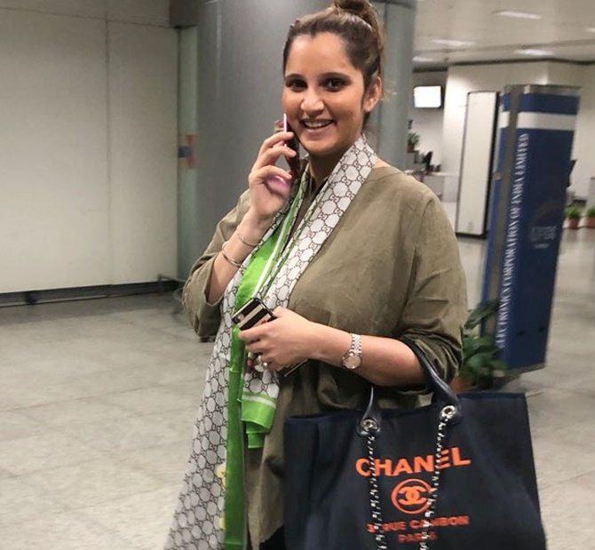 Rediff Sports - Cricket, Indian hockey, Tennis, Football, Chess, Golf - SPOTTED! Sania Mirza is back from Dubai