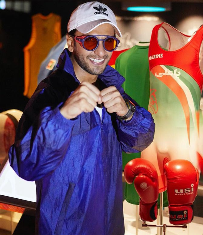 Rediff Sports - Cricket, Indian hockey, Tennis, Football, Chess, Golf - Mary Kom's gloves, Dhyan Chand's stick leave Ranveer spellbound