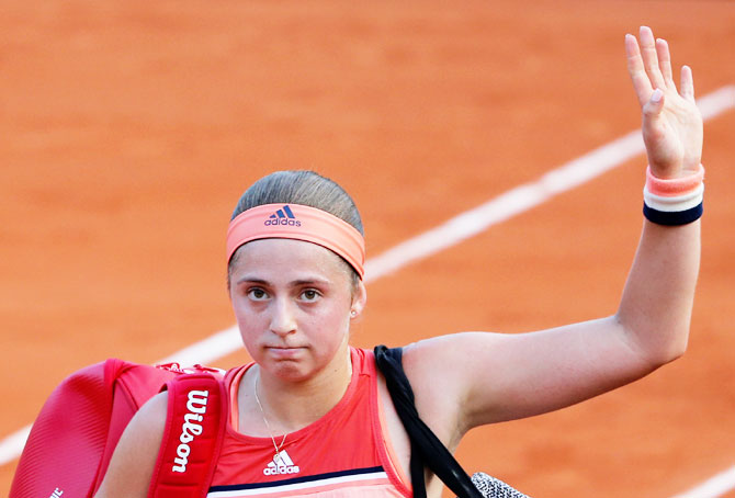 Latvia's Jelena Ostapenko reacts after losing her first round match against Ukraine's Kateryna Kozlova