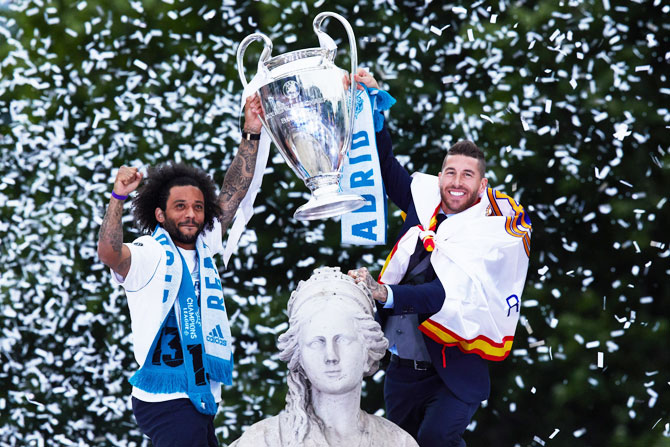 Real Madrid team celebrate their trophy at Cibeles Square