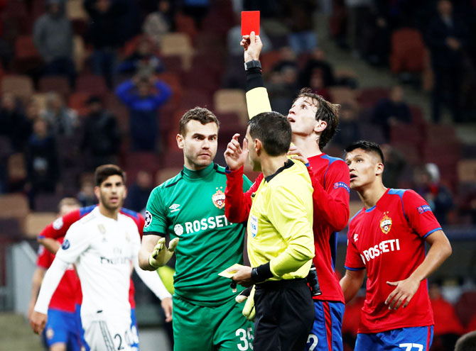 CSKA Moscow's Igor Akinfeev is shown a red card by referee Ovidiu Hategan just before the full-time whistle