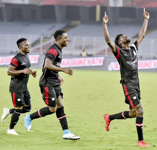 North East United FC Rowllin Borges celebrates a goal with teammates after scoring against ATK during their ISL match in Kolkata on Thursday