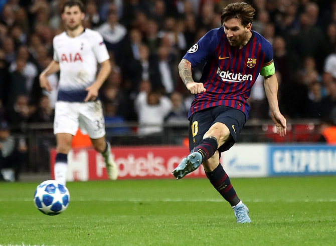 Barcelona's Lionel Messi scores the fourth goal against Tottenham