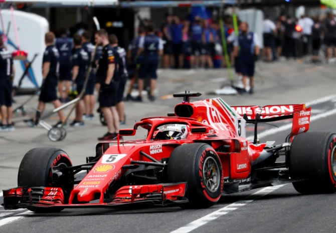 Rediff Sports - Cricket, Indian hockey, Tennis, Football, Chess, Golf - Vettel defends Ferrari's tyre gamble in Japan qualifying