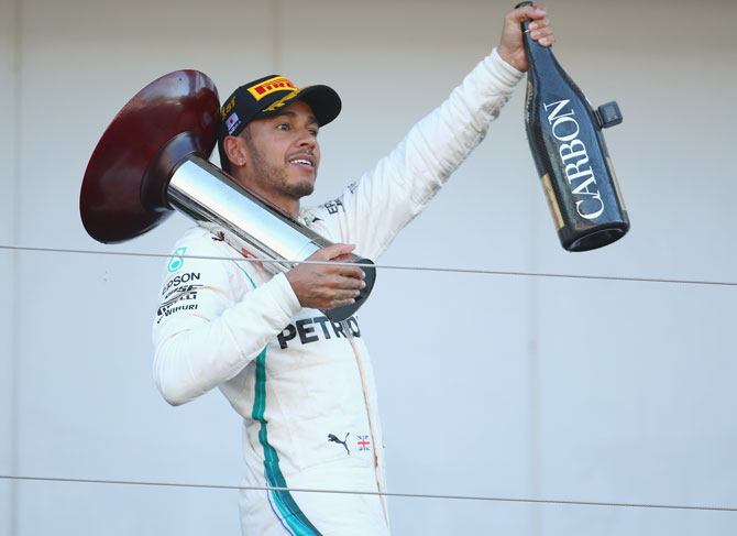 Rediff Sports - Cricket, Indian hockey, Tennis, Football, Chess, Golf - Hamilton wins in Japan; closes in on F1 title