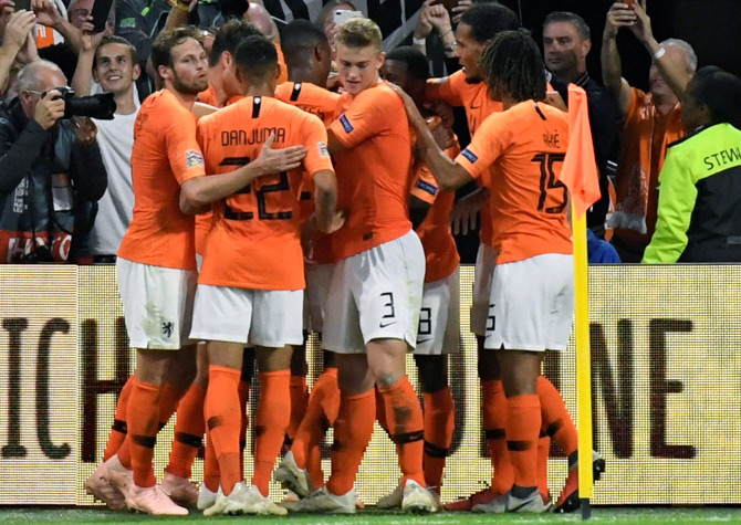 IMAGE  The Netherlands  players celebrate after Memphis Depay scored the  second goal. Photograph  Piroschka Van de Wouw Reuters bf5c42819