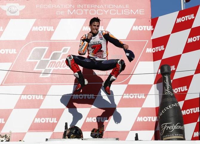 47abeae8db5f IMAGE  Repsol Honda s Marc Marquez celebrates winning the Japanese Grand  Prix MotoGP race and the MotoGP World title on the podium