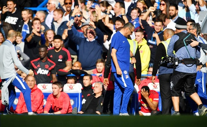 Chelsea coach charged with improper conduct after melee