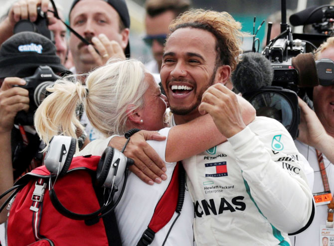 Rediff Sports - Cricket, Indian hockey, Tennis, Football, Chess, Golf - Mature Hamilton humbled by winning a fifth F1 title