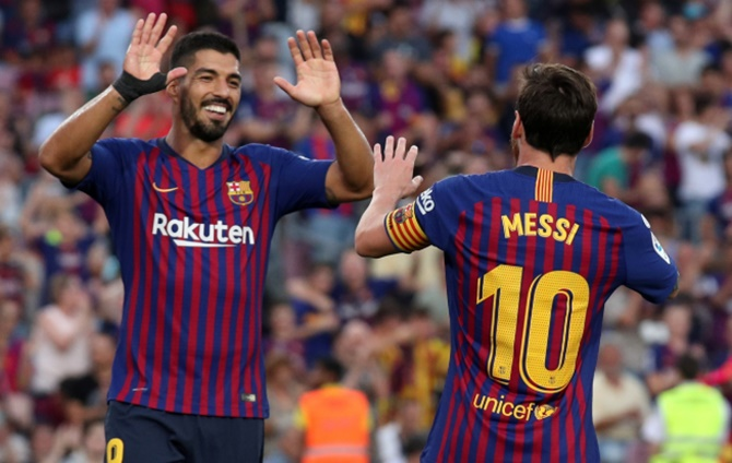 Rediff Sports - Cricket, Indian hockey, Tennis, Football, Chess, Golf - Messi and Suarez show no mercy as Barca humiliate Huesca
