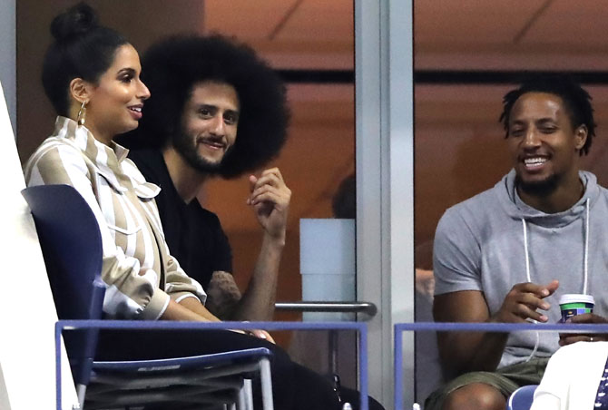 Former quarterback, Colin Kaepernick watches from the stands during the ladies singles third round match between Serena Williams and Venus Williams last week