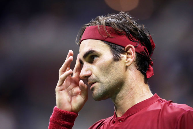 Roger Federer reacts during his US Open fourth round match against John Millman